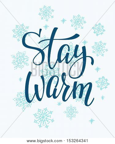 Winter cold lettering. Calligraphy postcard or poster graphic design sign element. Hand written vector style romantic quote. Stay warm. Snowflakes background