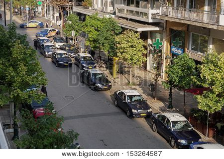 Thessaloniki, Greece - 24 October 2016: Taxis at a taxi stand at the city center. Blue and white parked taxis at Agias Sofias and Mitropoleos street by the Metropolitan church of Saint Gregory Palamas.