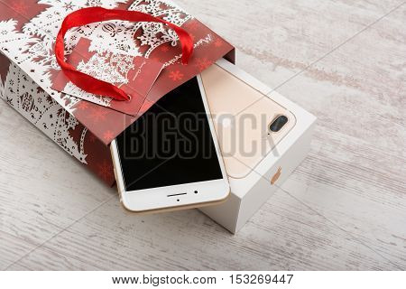 BURGAS, BULGARIA - OCTOBER 22, 2016: New Apple iPhone 7 Plus Gold on white background, Christmas gift, illustrative editorial.