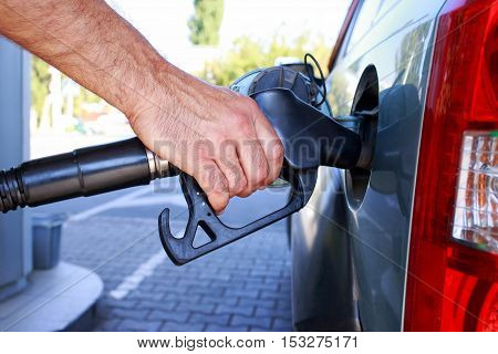 car fill with gasoline at a gas station
