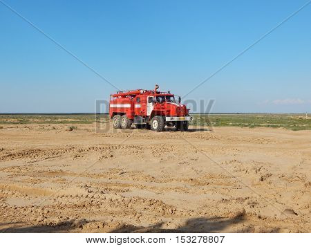 Firefighter car on desert background. fire, truck, car,