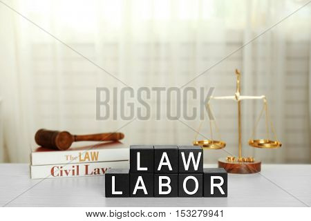 Black cubes with phrase LAW LABOR on white table