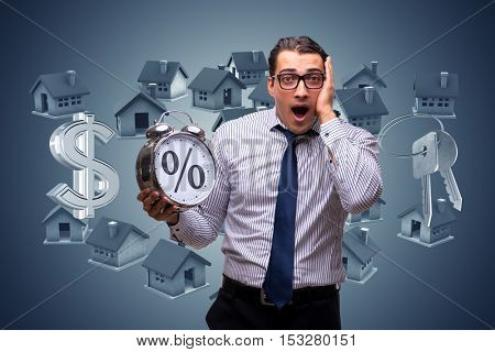 Young businessman surprised at high interest mortgage rates