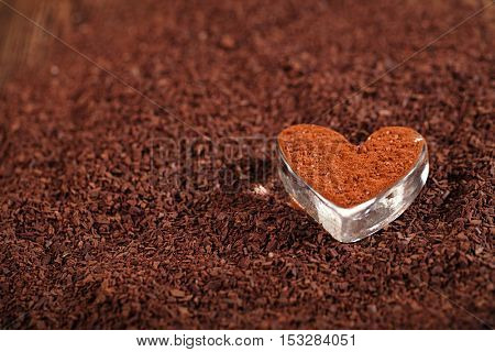 cocoa  powder  dusted heart shaped glass with grated chocolate, perfect color and background