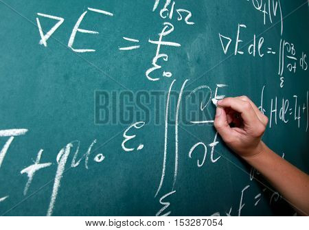 Integrals, differential equations and other calcululs/math problems on a blackboard