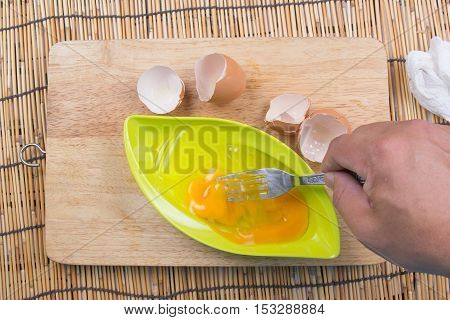 preparing omelet with eegs and forks /cooking fired rice concept