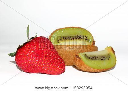 composition with strawberries and kiwi cutting on a white background