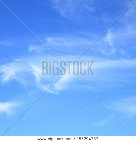 Fleecy clouds in blue sky, may be used as abstract background