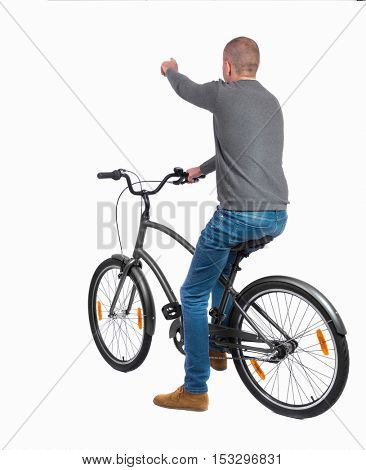 back view of pointing man with a bicycle. cyclist sits on the bike.  Rear view people collection.  backside view of person. Isolated over white background.