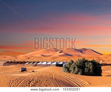 Camp site over sand dunes in Merzouga, Sahara desert in Morocco, Africa