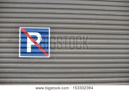 No parking loading zone sign against a building