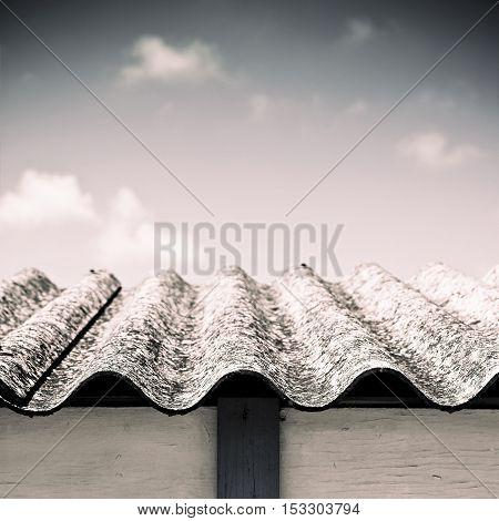 Dangerous asbestos roof detail - sepia toned