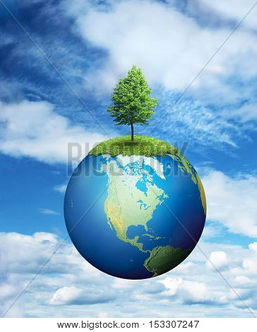 Lone tree growing on planet Earth environmental concept
