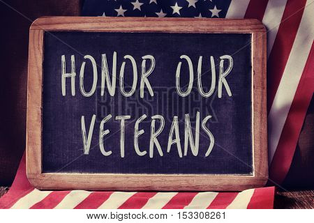 a chalkboard with the text honor our veterans and the flag of the United States