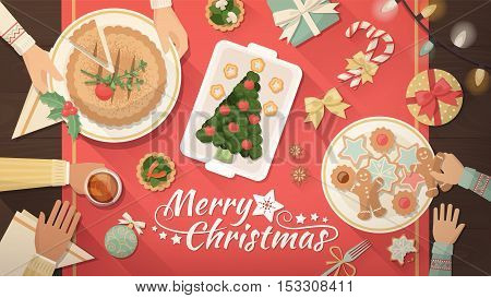 Family celebrating Christmas at home and eating together table top view flat lay