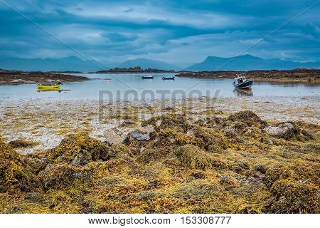 Boats On The Coast At Low Tide In Scotland