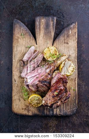 Barbecue Lamb Knuckles on old Cutting Board