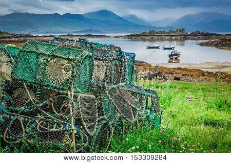 Cage For Lobster And Bay With Boats In Scotland