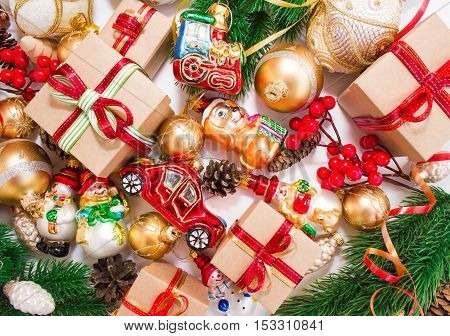 Christmas or New Year background: fur-tree, branches, gifts, colored glass balls and toys, decoration and cones on a white background