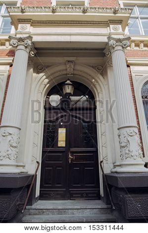 Huge Classical Antic Door Made Of Wood With Many Ornaments