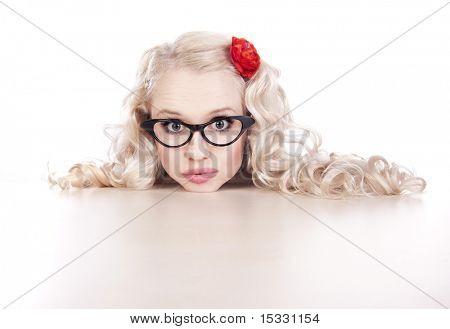Funny girl resting on a desk