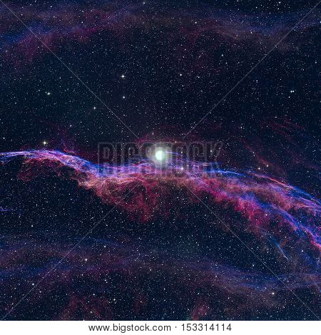 The Veil Nebula or The Witch's Broom Nebula is a cloud of heated and ionized gas and dust in the constellation Cygnus. Elements of this image furnished by NASA.