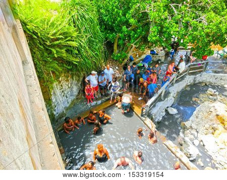 Soufriere Saint Lucia - May 12 2016: The tourists swimming at the Sulphur Springs Drive - in Volcano near Soufriere Saint Lucia