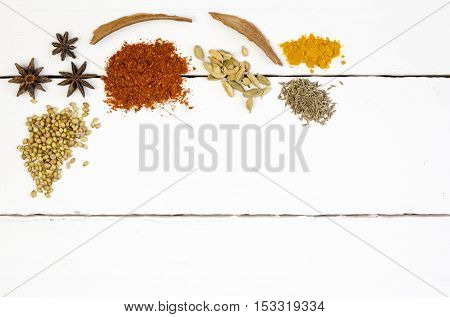 Photo of heaped spices on white table closeup
