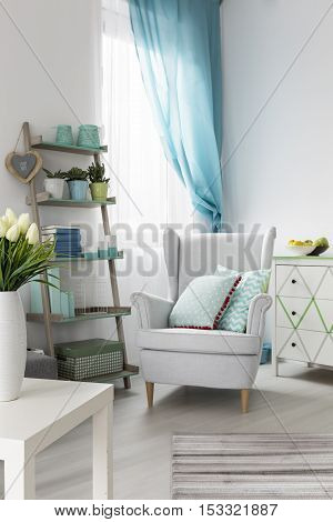 Comfortable Living Room Interior With Armchair And Stylish Shelf