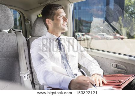 Businessman Sitting On A Backseat In A Taxi