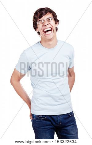Young hispanic man wearing glasses, blue t-shirt and jeans standing with hands his back pockets and loudly laughing isolated on white background - laughter concept
