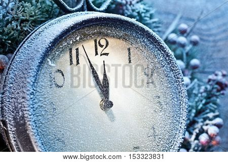 Five minutes to twelve. Snowy Christmas clocks.