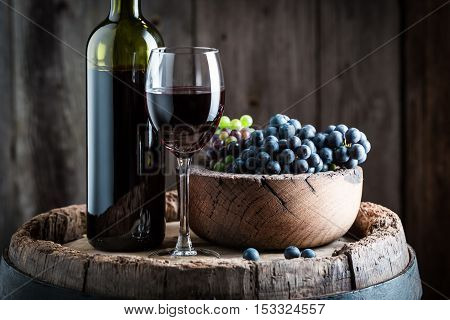 Intensive Red Wine With Sweet Grapes On Wooden Barrel