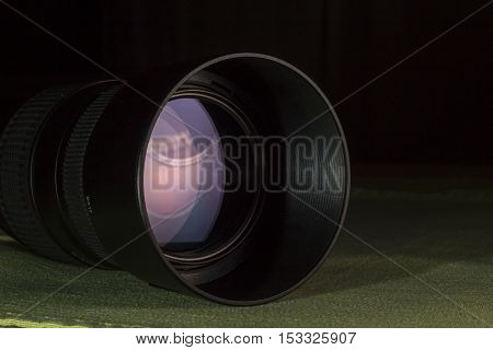Telephoto lens aperture close up with nice reflections.