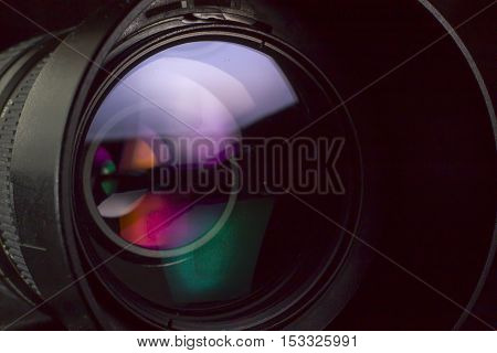Telephoto lens aperture with nice reflections. Photography vision concept.