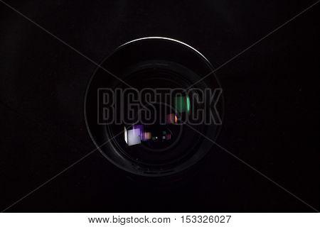 Telephoto lens aperture close up concept. Dark silhouete photo.