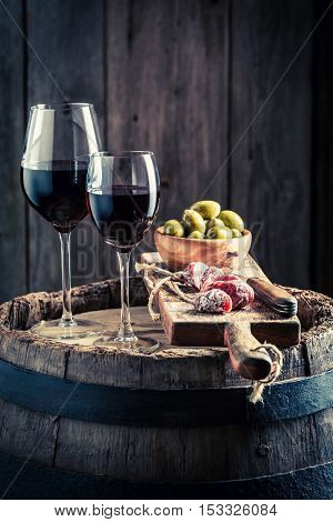 Tasty Wine In Glass With Cold Meats And Olives On Wooden Board