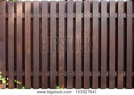 new modern wooden fence dark brown color