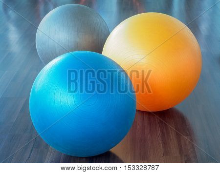 Color filter image, Fitness rubber balls on parquet floor (fitness, ball, yoga)