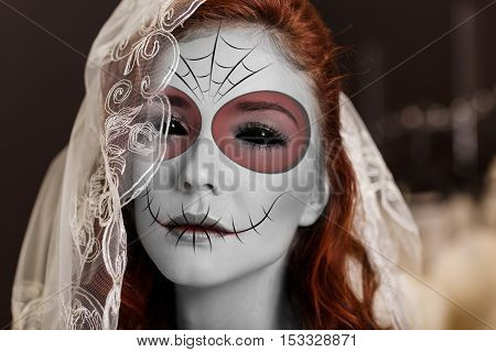 Beautiful bride in day of the dead mask skull face art