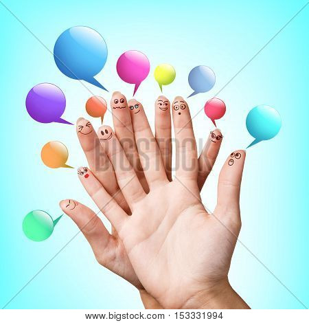 Happy finger smileys with colorful speech bubbles over blue background