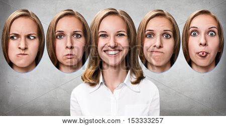 Young girl changes her face portraits with different emotions over gray background