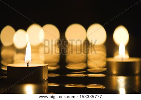 Beautiful candlelight and reflection of burning candles in the background