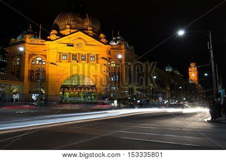 Flinders Street Station In Melbourne With Traffic At Night