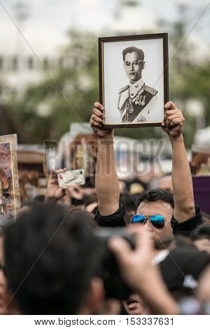 BANGKOK, Thailand - OCT 22: Unidentified people lift His Majesty King Bhumibol Adulyadej photo on October 22,2016 Bangkok, Thailand. Thailand's King has died after 70 years as head of state.