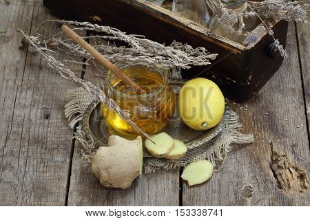 Still life with gingerlemonhoney and Provencal herbs on a wooden table