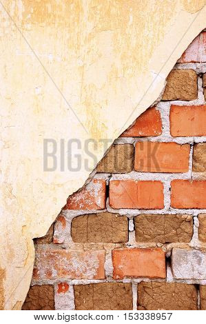 Damaged old brick wall with plaster remains, showing the brick structure, composed of ceramic and old pressed dirt bricks, background, concept, metaphor
