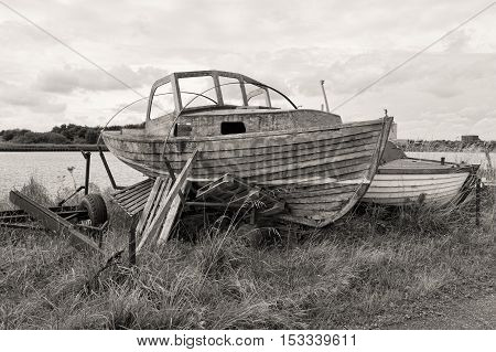 Black and white shot of old boats on a coast at Horsens Denmark