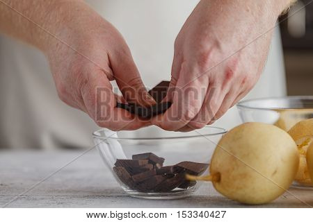 male hand breaking choco for  Making Chocolate Cream.