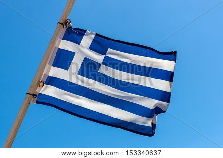 National Greek flag on the yardarm of the ship